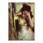 Woman Combing Her Hair before a Mirror - Degas Poster
