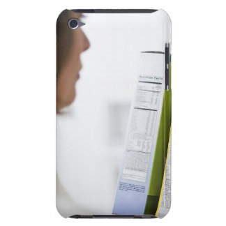 Woman comparing nutrition labels iPod Case-Mate case