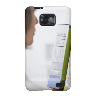 Woman comparing nutrition labels samsung galaxy s2 cover