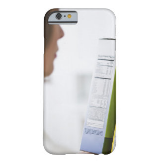 Woman comparing nutrition labels barely there iPhone 6 case