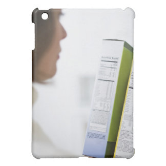 Woman comparing nutrition labels iPad mini cover