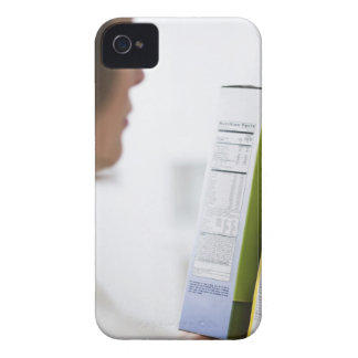 Woman comparing nutrition labels iPhone 4 case