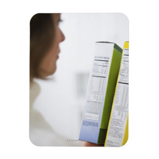 Woman comparing nutrition labels magnet