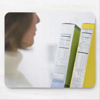 Woman comparing nutrition labels mouse pad