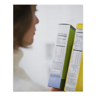 Woman comparing nutrition labels poster