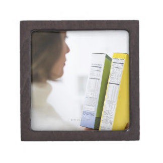 Woman comparing nutrition labels premium gift box