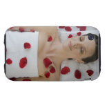 Woman covered in flower petals laying on massage tough iPhone 3 covers