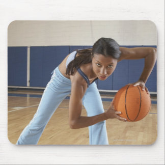 Woman crouching with basketball, portrait mouse pad