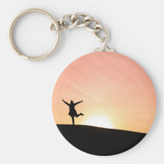 Woman dancing against the setting sun basic round button keychain