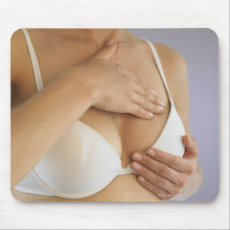 Woman doing breast self exam mouse pad