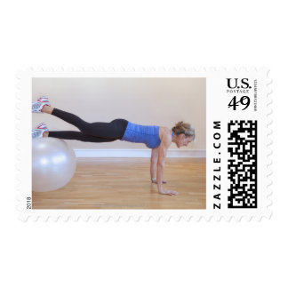 Woman doing exercise pose postage