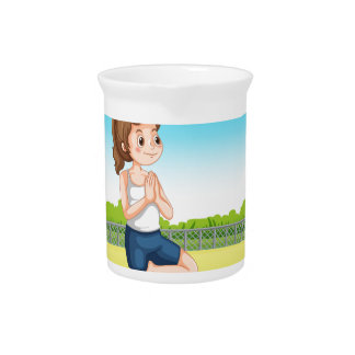 Woman doing yoga in the park beverage pitcher