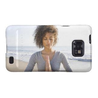 Woman doing yoga on beach galaxy s2 covers