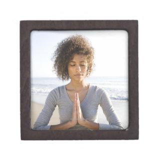 Woman doing yoga on beach jewelry box
