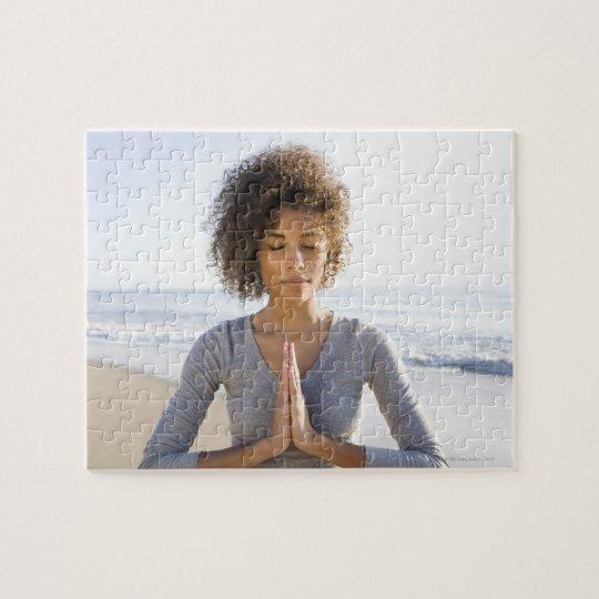 Woman doing yoga on beach jigsaw puzzle