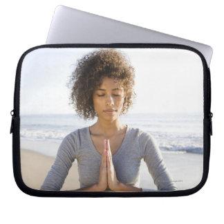 Woman doing yoga on beach laptop computer sleeves