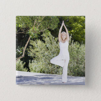 Woman doing yoga on patio button