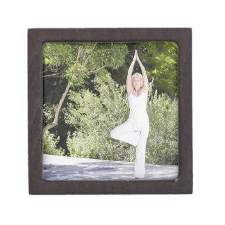 Woman doing yoga on patio keepsake box