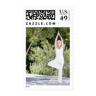 Woman doing yoga on patio stamps