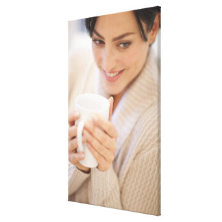 Woman drinking a hot drink. canvas print