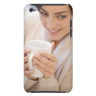 Woman drinking a hot drink. iPod touch case