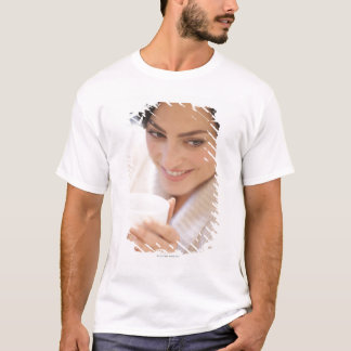 Woman drinking a hot drink. T-Shirt