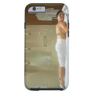 Woman enjoying hydrotherapy in vichy shower tough iPhone 6 case