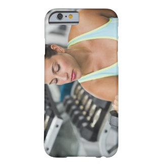 Woman exercising with dumbbells barely there iPhone 6 case