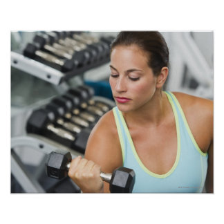 Woman exercising with dumbbells posters