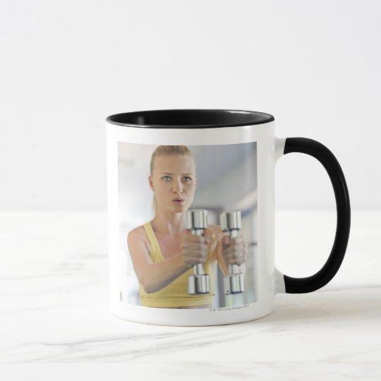 Woman exercising with weights mug
