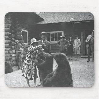 Woman feeding bears. mouse pad