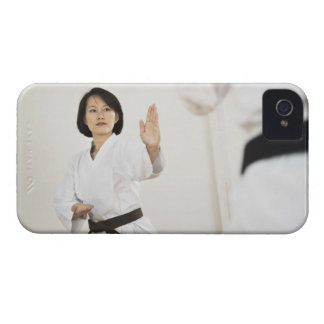 Woman fighting in karate competition iPhone 4 Case-Mate case