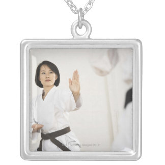 Woman fighting in karate competition silver plated necklace