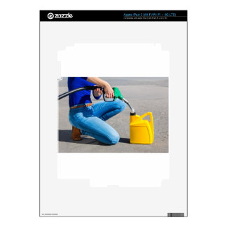Woman filling yellow can with gasoline or petrol. decals for iPad 3