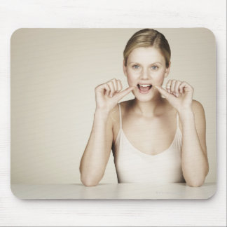 Woman flossing her teeth mouse pad