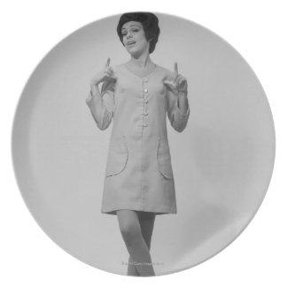 Woman Gesturing Plate