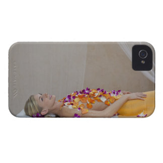 Woman getting a flower treatment at a spa. iPhone 4 Case-Mate case