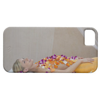Woman getting a flower treatment at a spa. iPhone SE/5/5s case