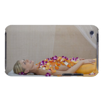 Woman getting a flower treatment at a spa. iPod touch case
