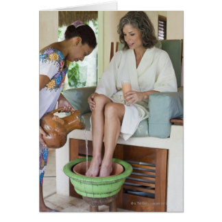 Woman getting a footbath at a spa in Mexico. Card