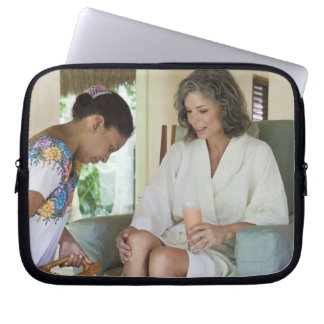 Woman getting a footbath at a spa in Mexico. Computer Sleeve