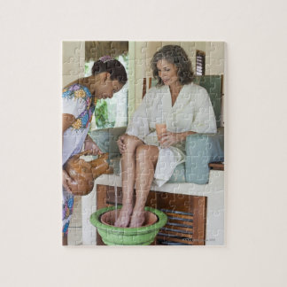 Woman getting a footbath at a spa in Mexico. Jigsaw Puzzle