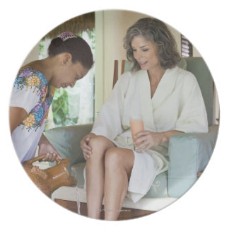 Woman getting a footbath at a spa in Mexico. Melamine Plate