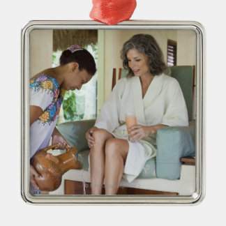 Woman getting a footbath at a spa in Mexico. Metal Ornament