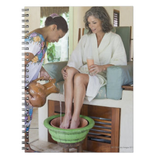 Woman getting a footbath at a spa in Mexico. Notebook