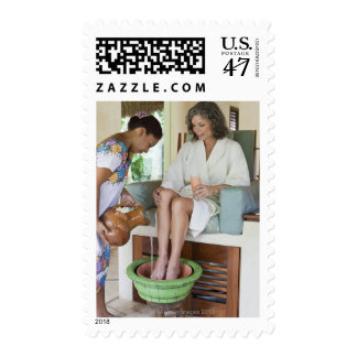 Woman getting a footbath at a spa in Mexico. Postage