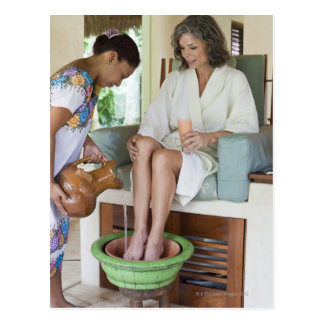 Woman getting a footbath at a spa in Mexico. Postcard
