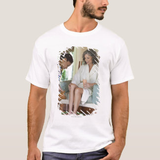 Woman getting a footbath at a spa in Mexico. T-Shirt