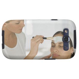 Woman getting beauty mud mask galaxy SIII case