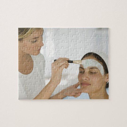Woman getting beauty mud mask jigsaw puzzle